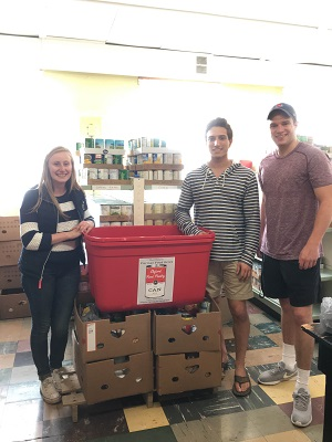 Students with donations at Oxford Community Choice Food Pantry