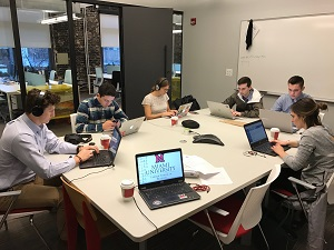 Venture capitalist team working in conference room