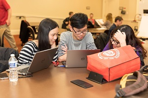 Students working on data at Datafest
