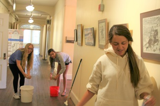 Students cleaning the Oxford Community Arts Center