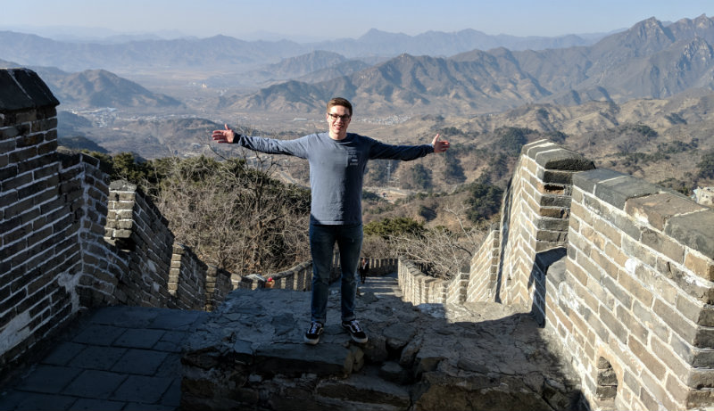 Michael Reimer standing on the Great Wall of China