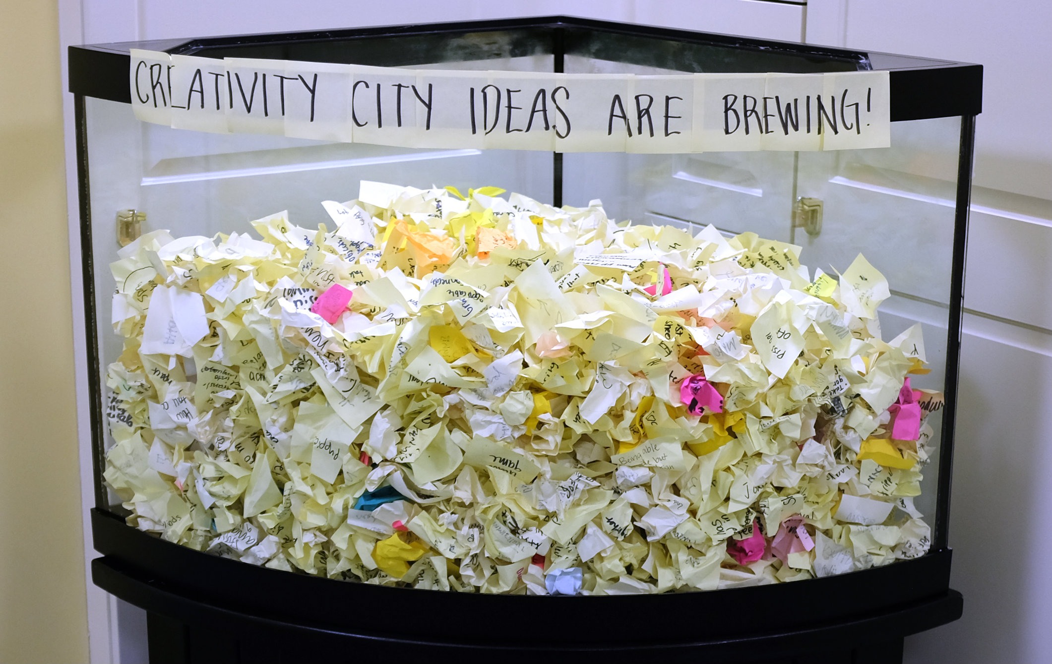 Creativity City ideas on small papers, crumpled in fishtank