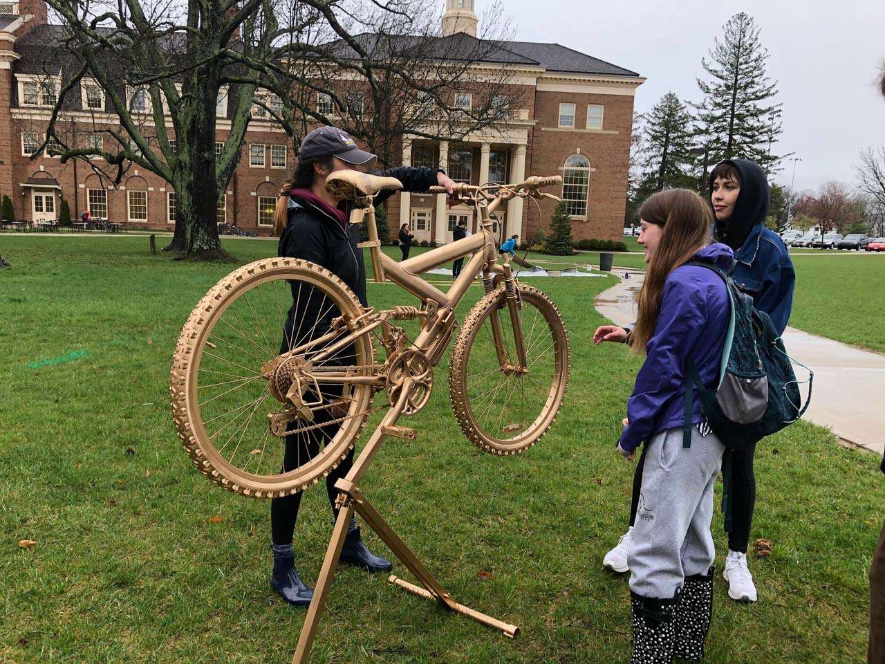 Creativity City preparations with gold-painted bike