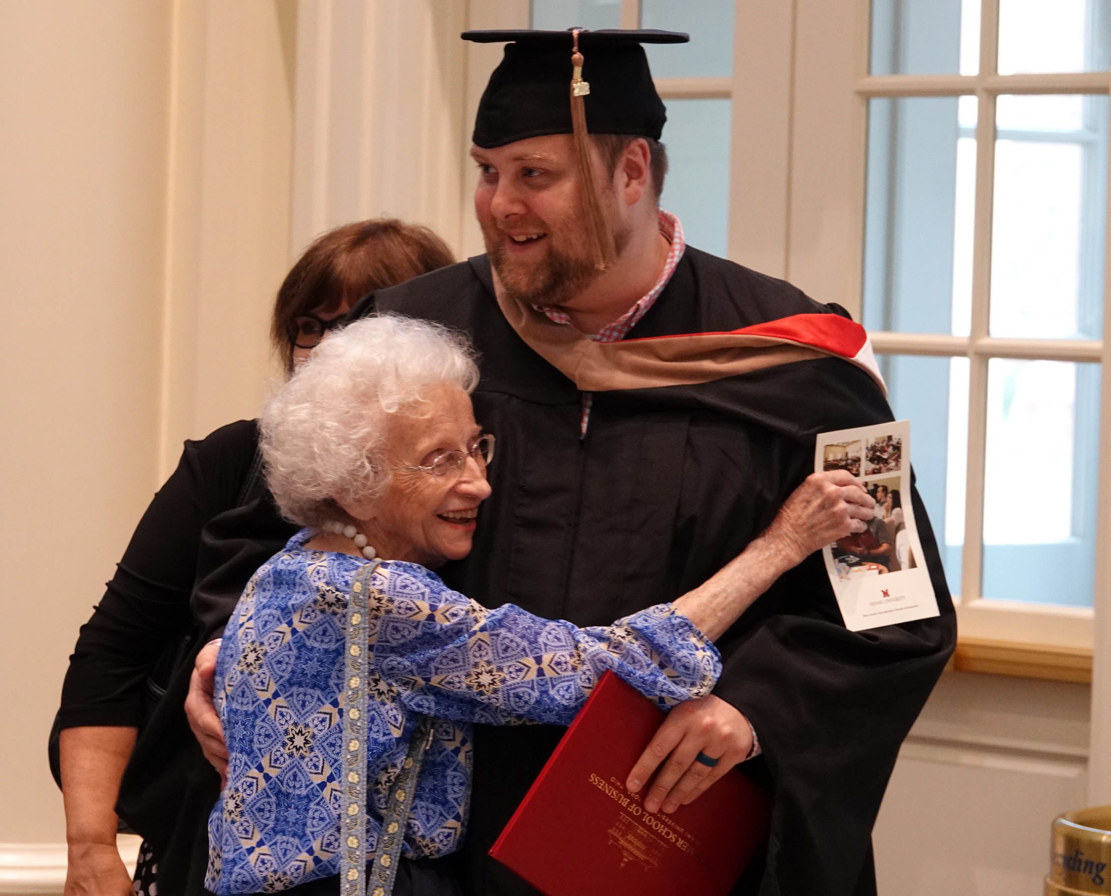 Graduate gets hug from grandmother