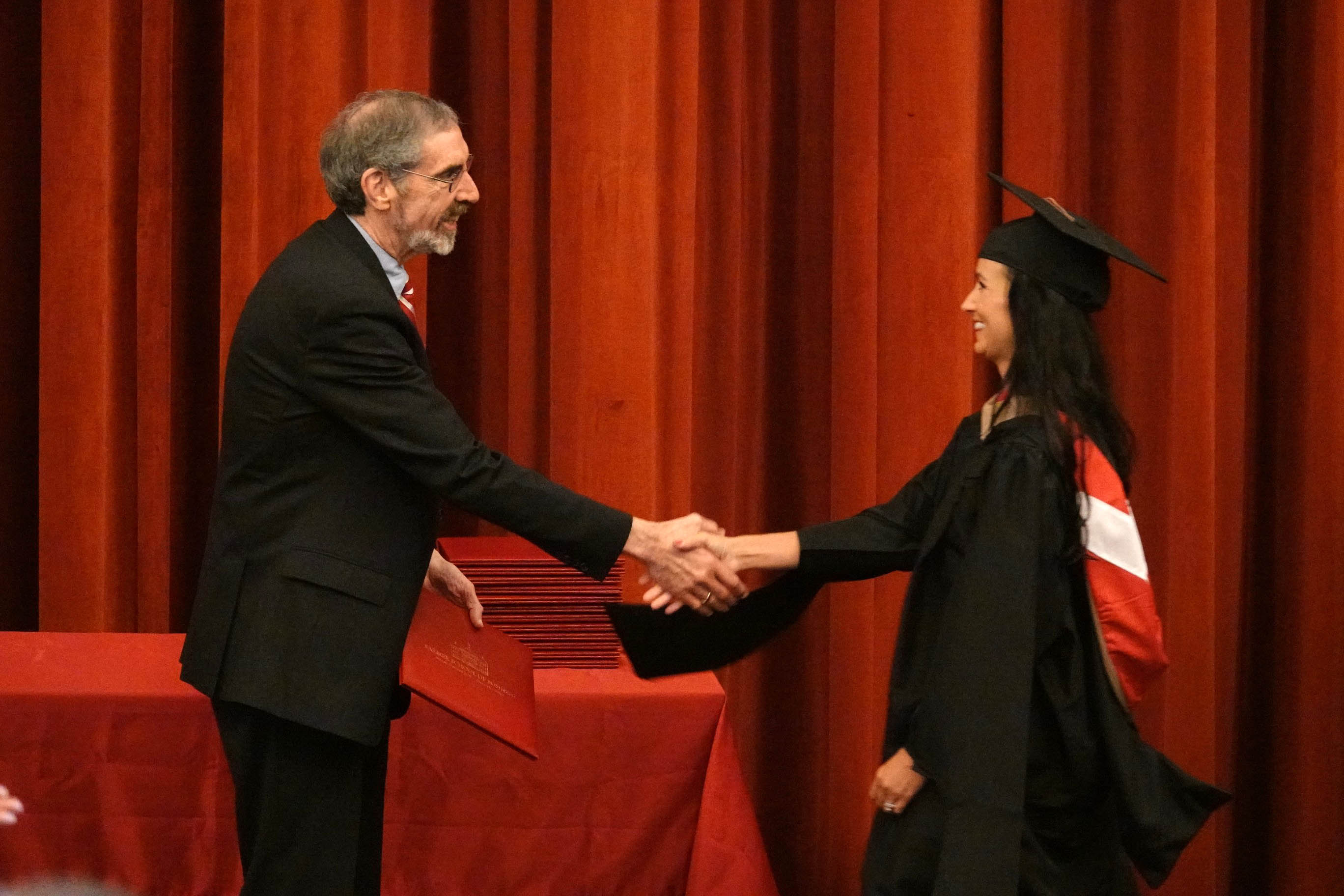 Graduate poses with Dean Marc Rubin