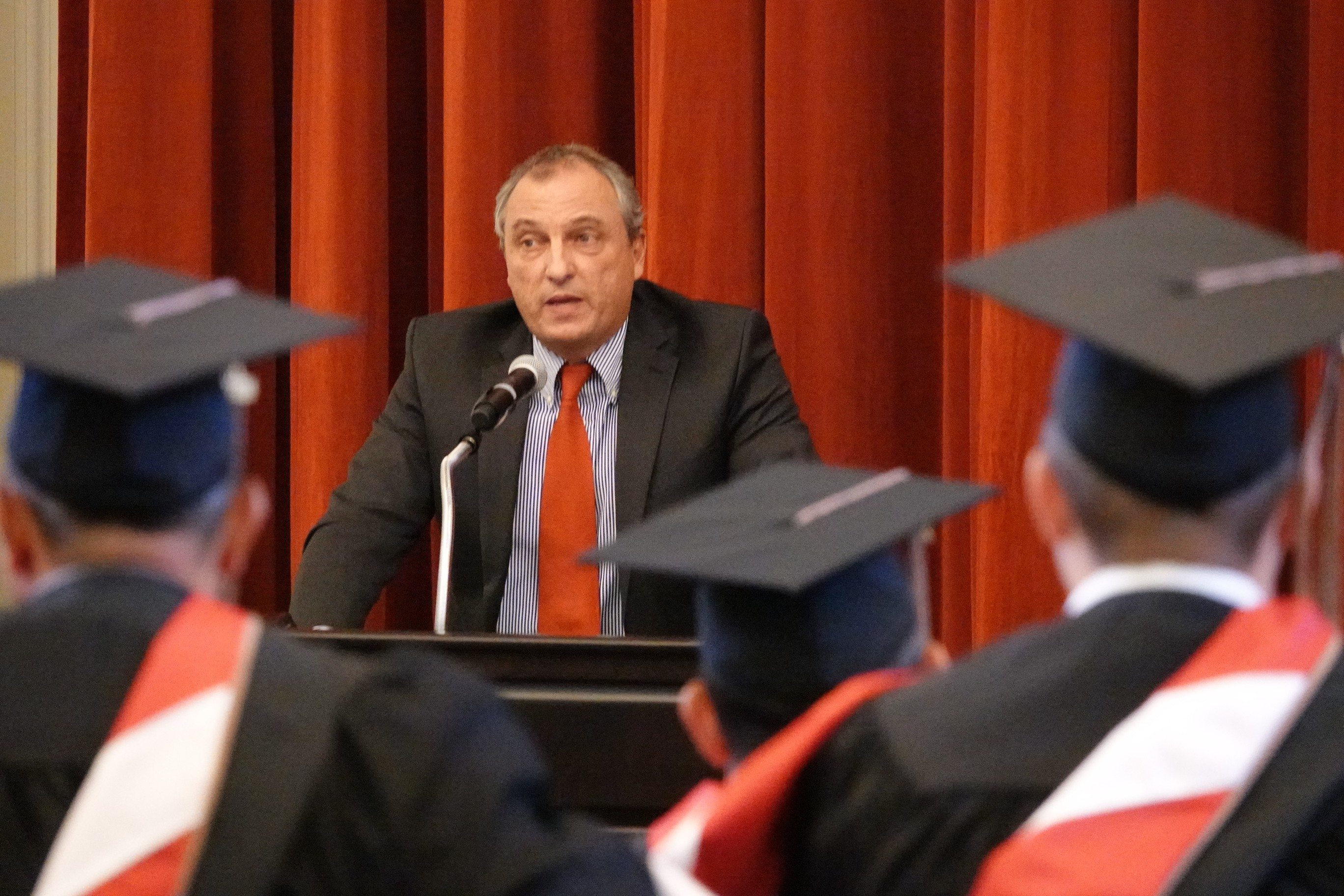 Alex Tosolini talking to graduates
