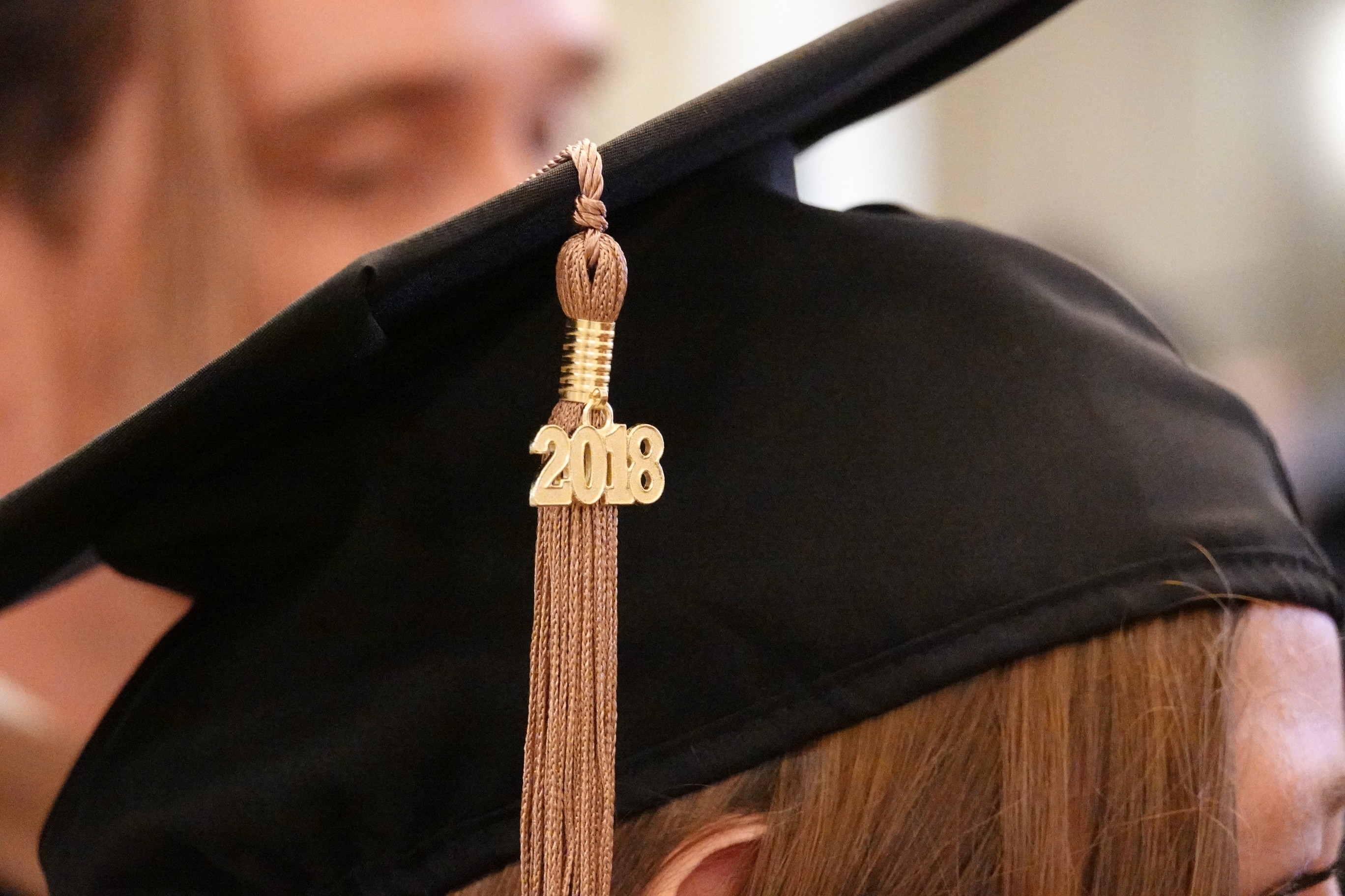 Close shot of 2018 badge on tassel