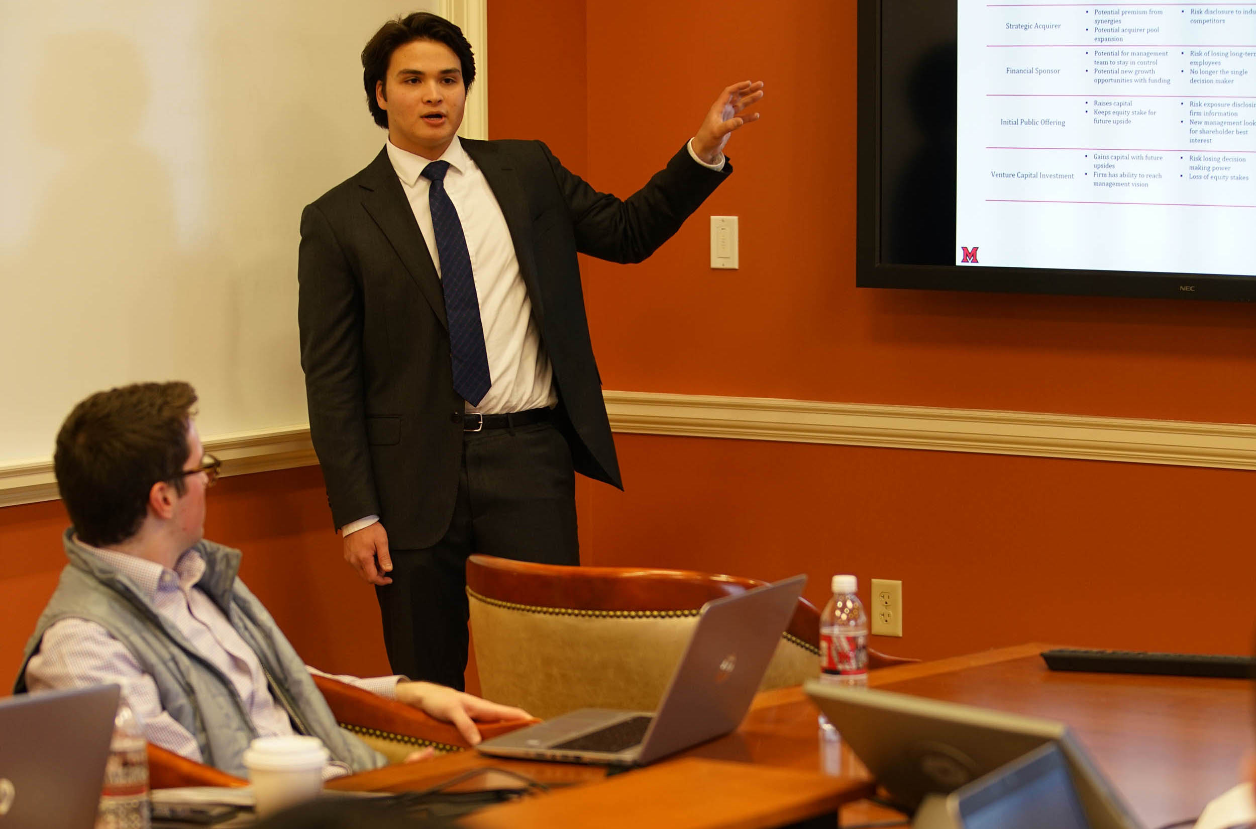Student makes final presentation to William Blair executives
