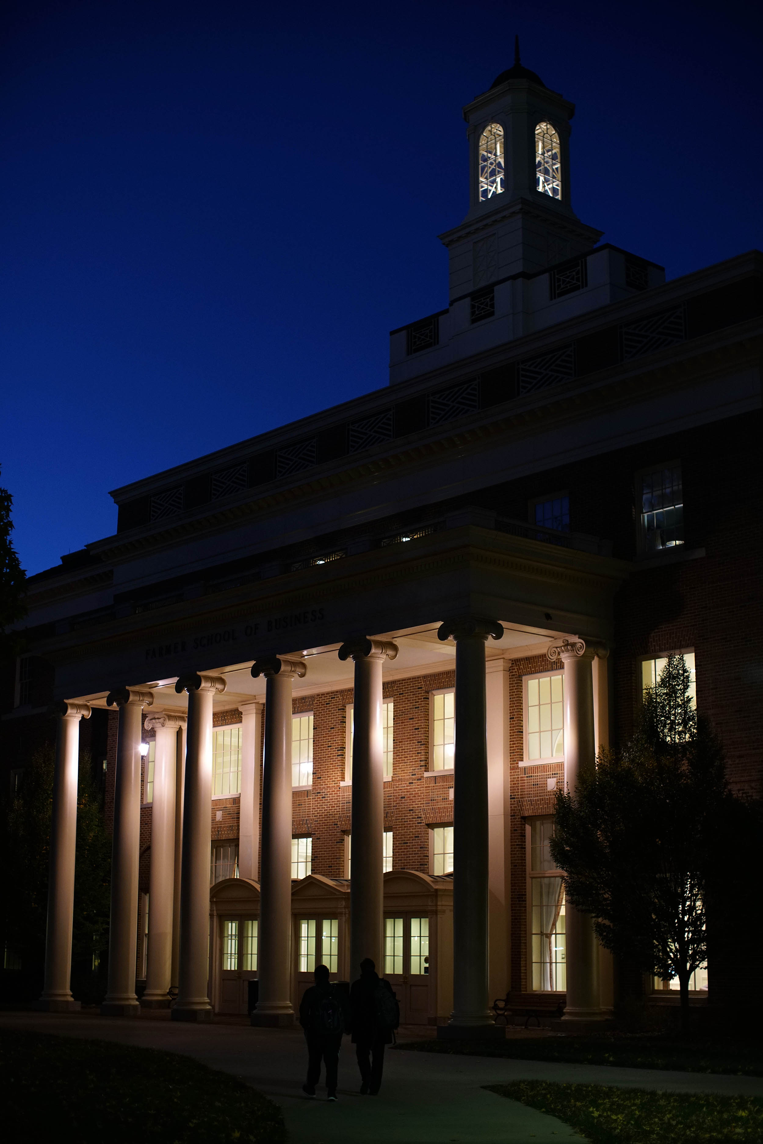 Late evening view of the front of the Farmer School of Business